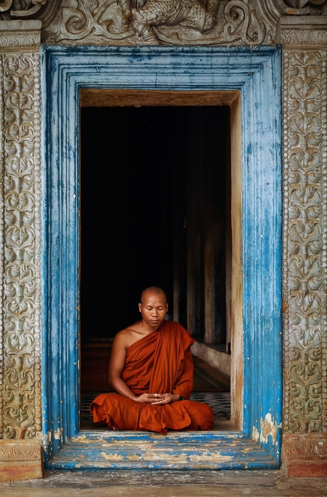 A piece of fine art art photography titled The Monks of Wat Bo by Leah Kennedy