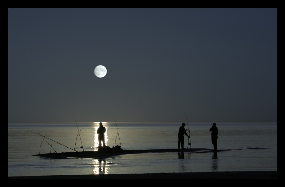 A piece of fine art art photography titled Moonlight Fishing by Karlis Keisters