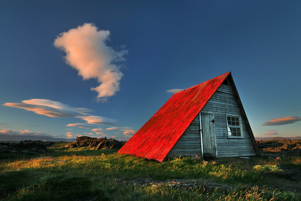 A piece of fine art art photography titled The Red Roof by Bragi Ingibergsson - BRIN