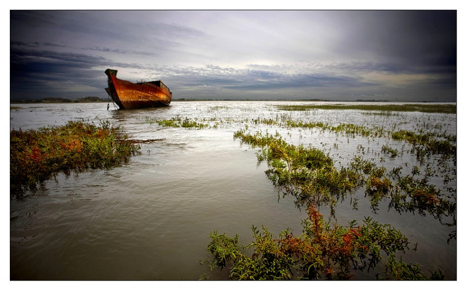 A piece of fine art art photography titled Boat Graveyard by Tim Johnstone