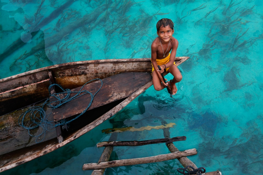 A piece of fine art art photography titled Bajau Boy by Hesham Alhumaid