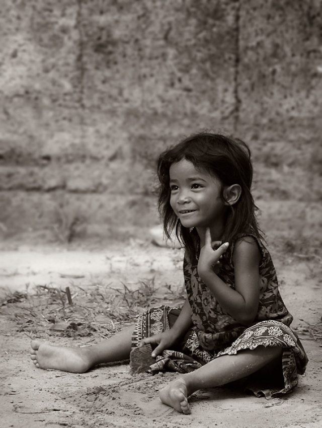 A piece of fine art art photography titled Innocence at Angkor by Craig Martin