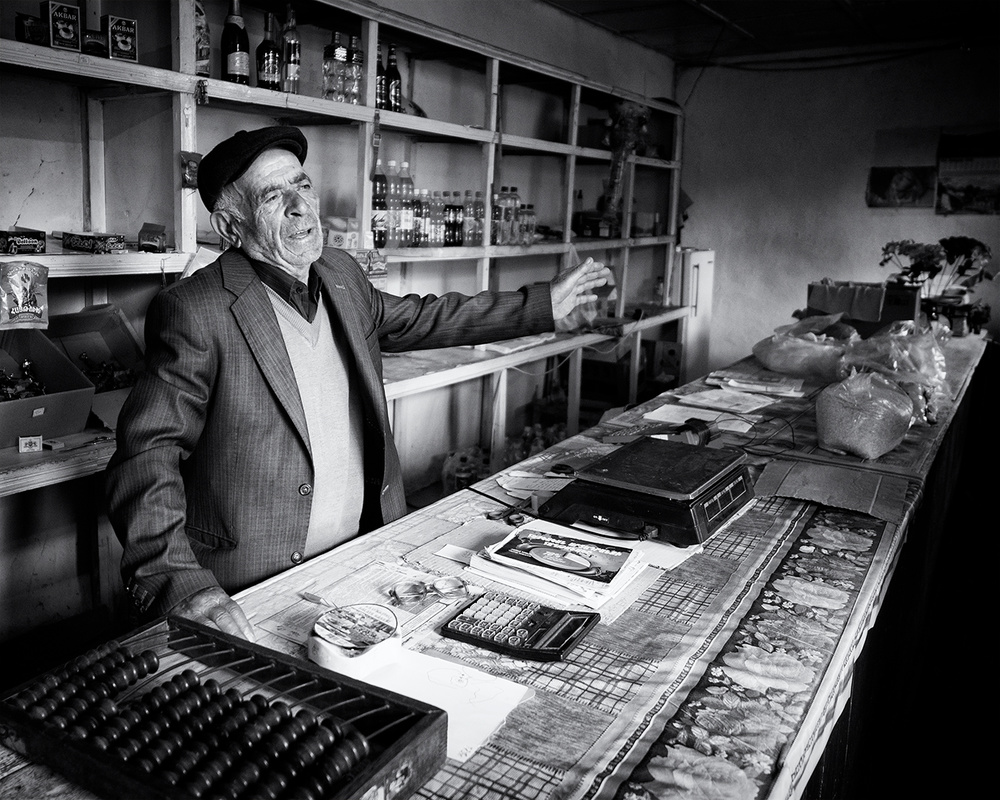 A piece of fine art art photography titled Shopkeeper by Marcel Rebro