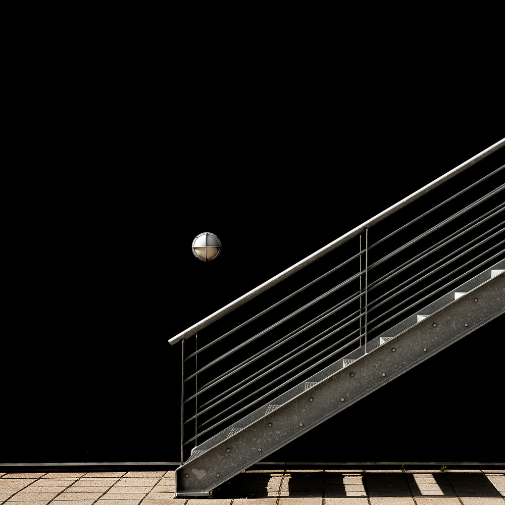 A piece of fine art art photography titled A Staircase and a Lamp by Inge Schuster
