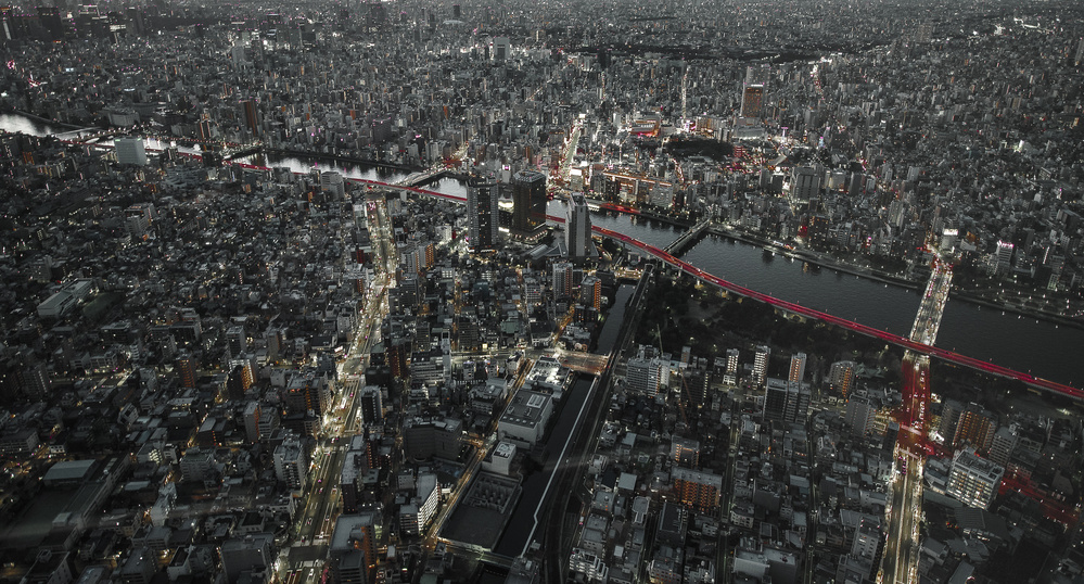 A piece of fine art art photography titled Red Line In the Dark Tokyo by Carmine Chiriaco