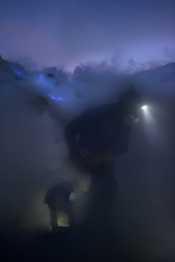 A piece of fine art art photography titled Kawah Ijen Miners by Roberto Marchegiani