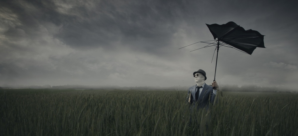 A piece of fine art art photography titled Umbrella Man by jesper karstensen