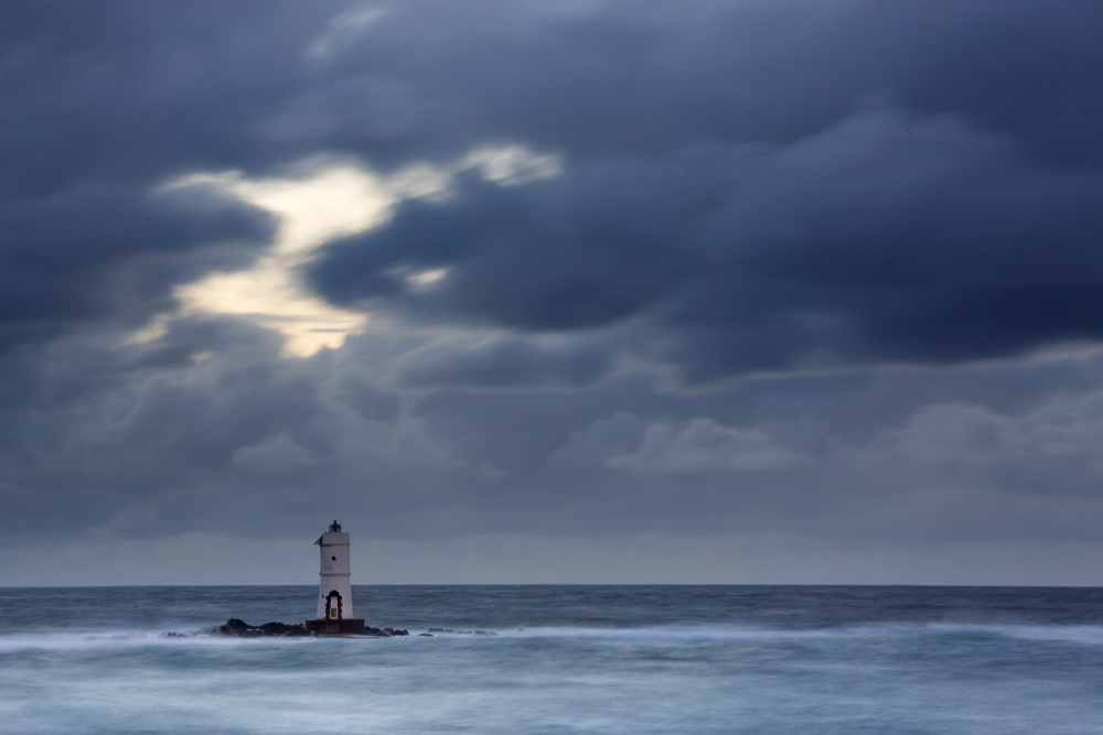 A piece of fine art art photography titled Mangiabarche Lighthouse by Alessandro Carboni