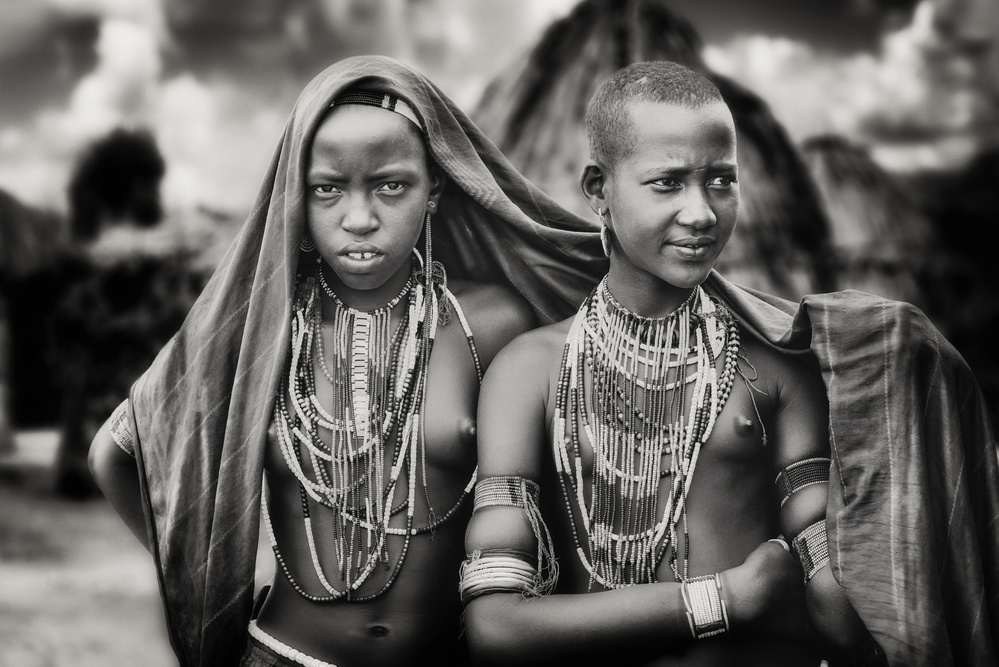 A piece of fine art art photography titled Karo Girls Sharing a Scarf by Piet Flour