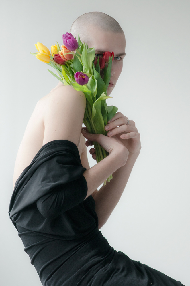 View this piece of fine art photography titled Oliver and tulips by Arkadiusz Makowski