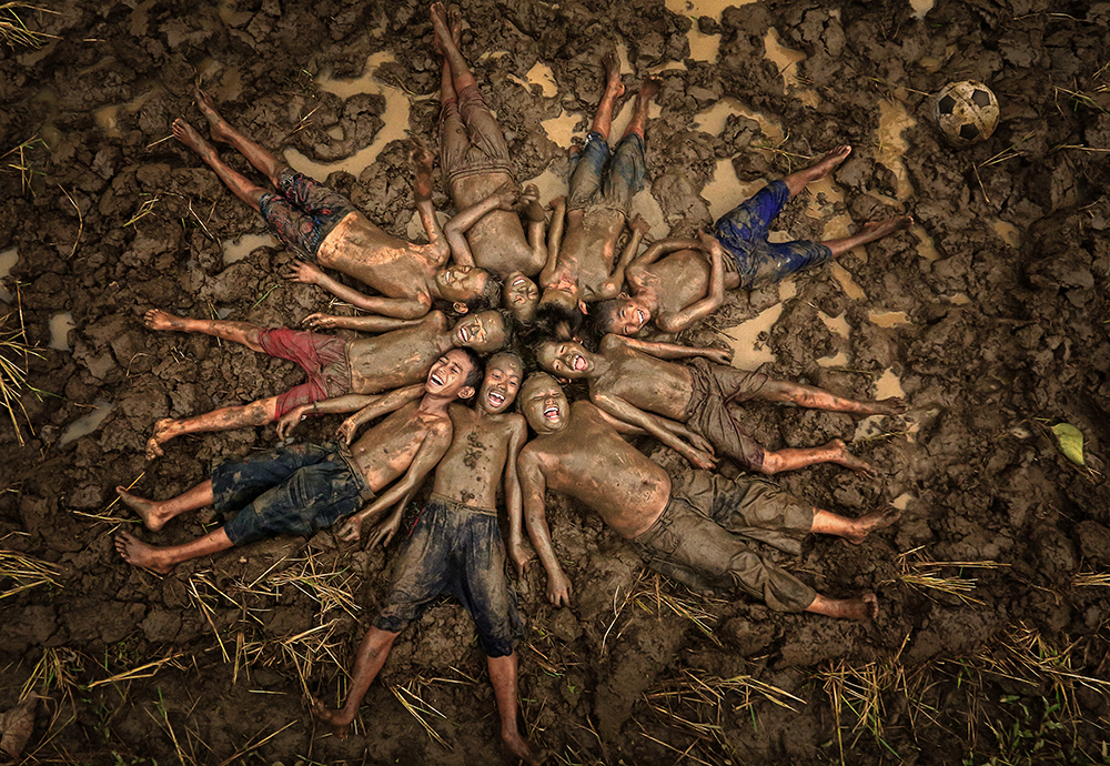 A piece of fine art art photography titled Happy In the Mud by Alamsyah Rauf
