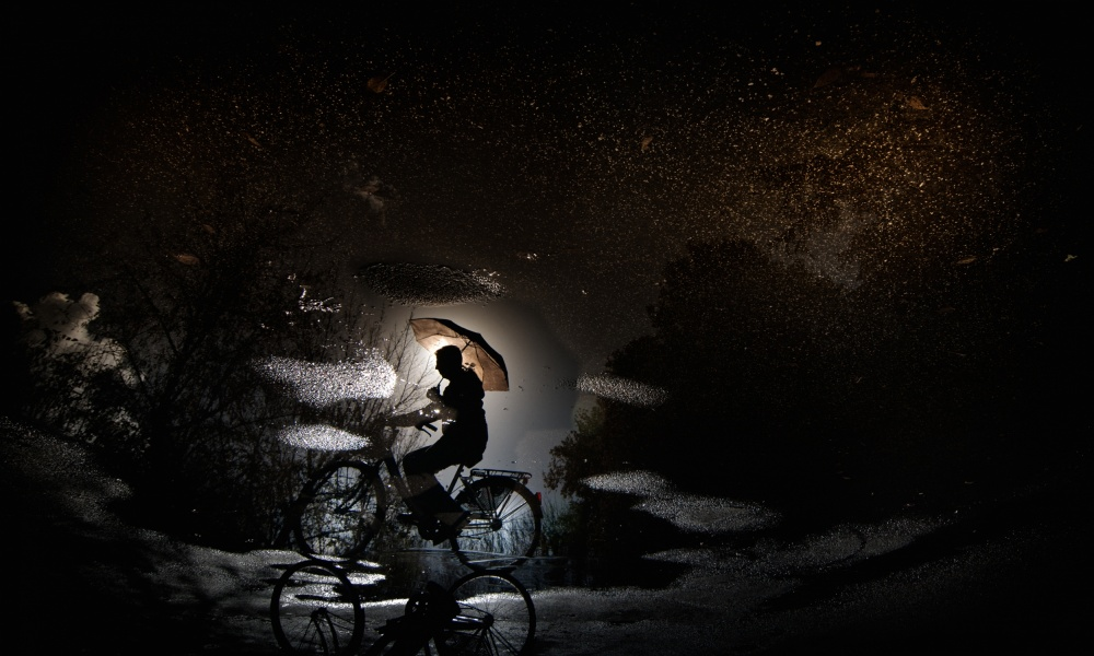 A piece of fine art art photography titled Pedaling by Bicycle by Antonio Grambone