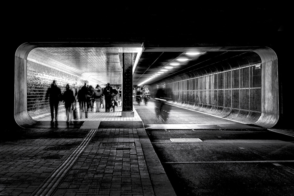 Hasty people on a Friday evening in the tunnel.