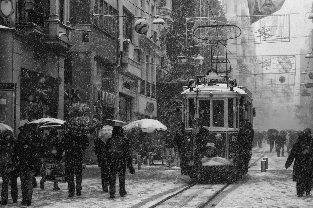 A piece of fine art art photography titled Istiklal Street On a Snowy Day  by namık toprakçı