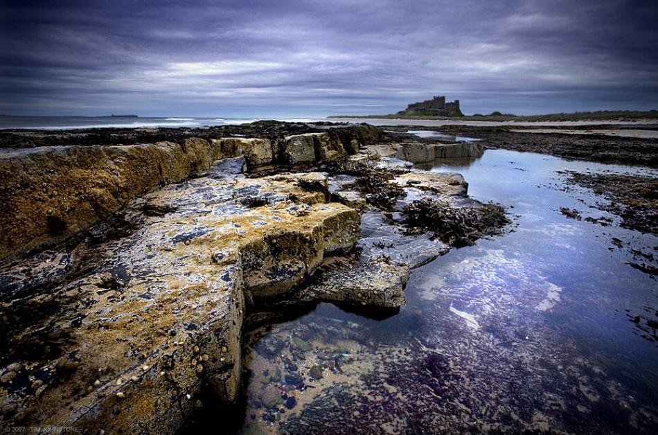 A piece of fine art art photography titled Bamburgh Castle by Tim Johnstone