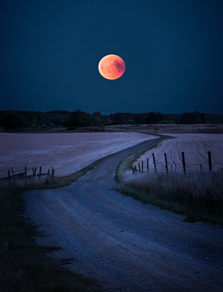 A piece of fine art art photography titled Bloodmoon 2018 by Christian Lindsten
