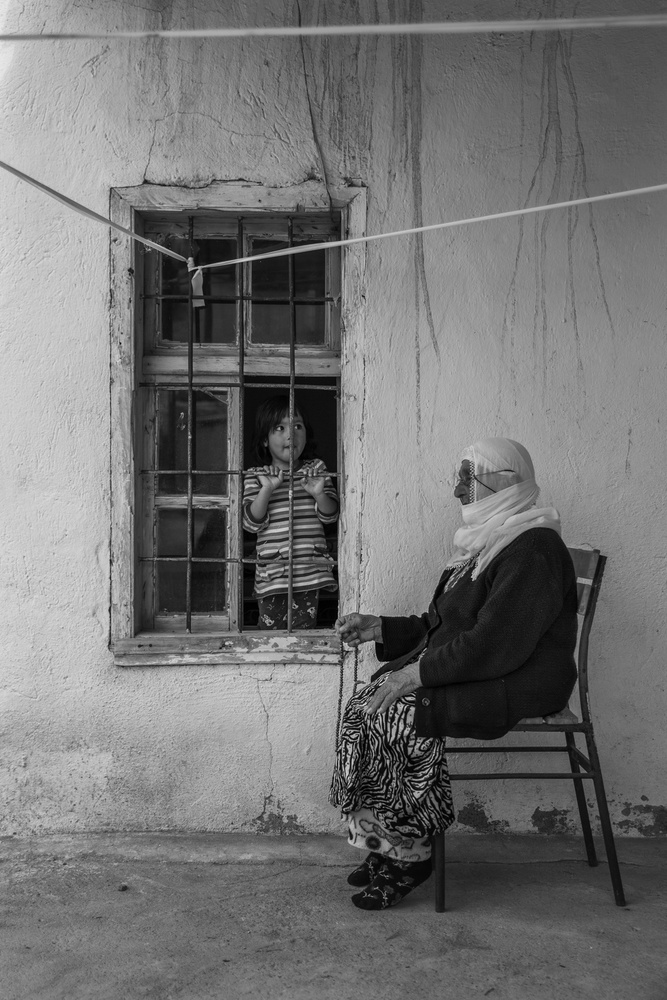 A piece of fine art art photography titled Child and GrandMother by Ferhat Gursu