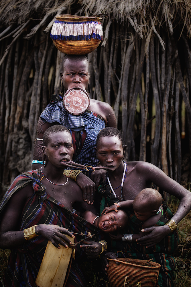 A piece of fine art art photography titled Mursi Tribe by Herman Morrison