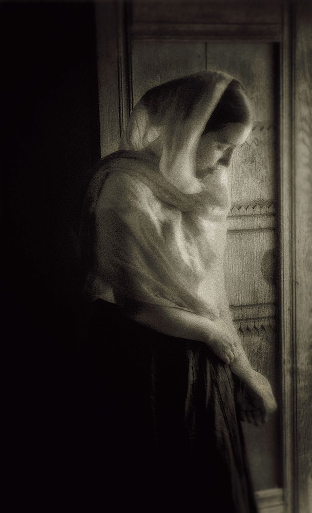 A piece of fine art art photography titled Golandrinas, NM Young Woman at Door by Andrew Michael