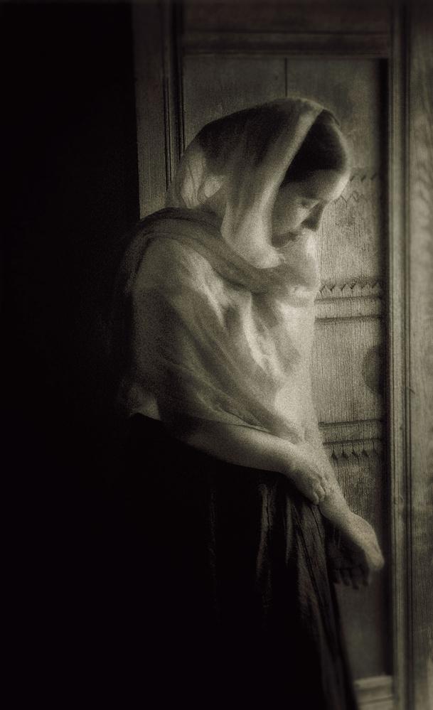 Golandrinas, NM Young woman at door