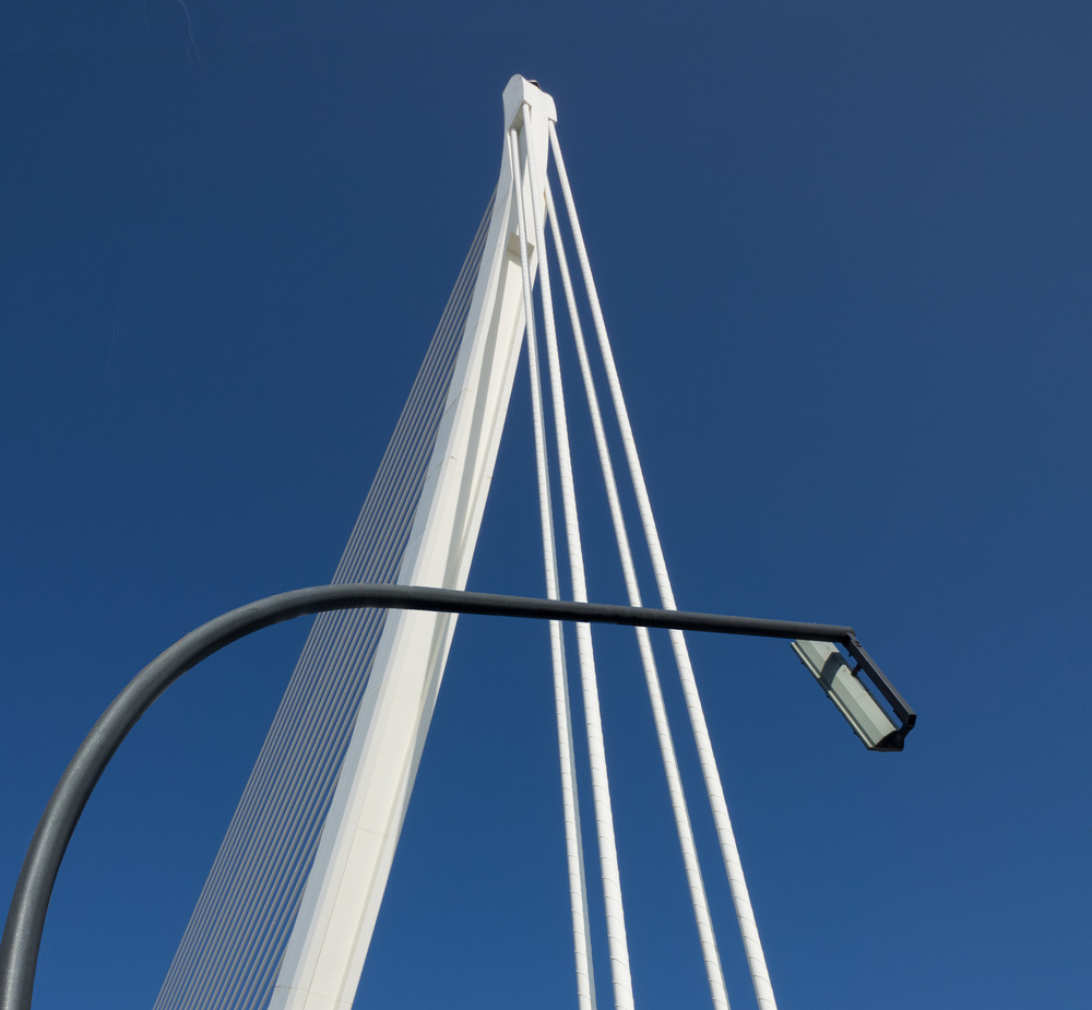 A piece of fine art art photography titled Lamp and Bridge Detail by John Bull