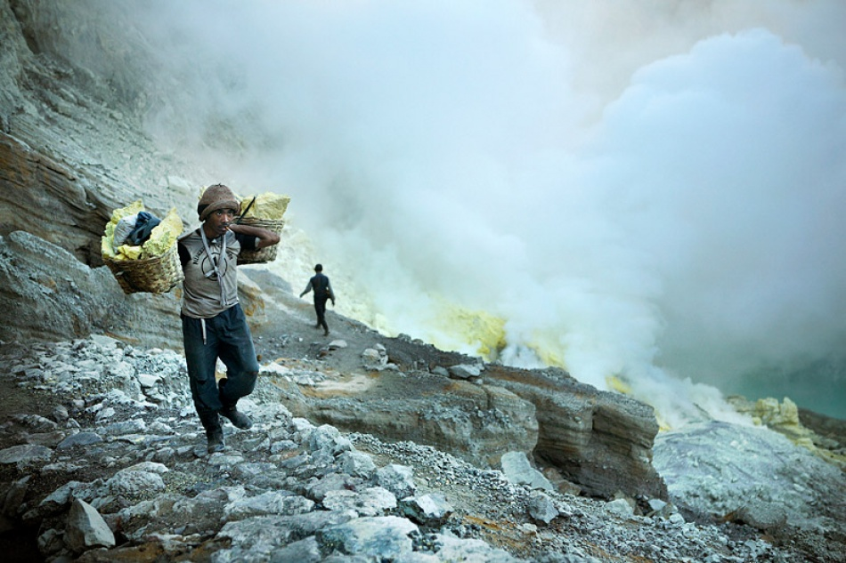 A piece of fine art art photography titled Working at the Ijen Crater by Mitchell Kanashkevich