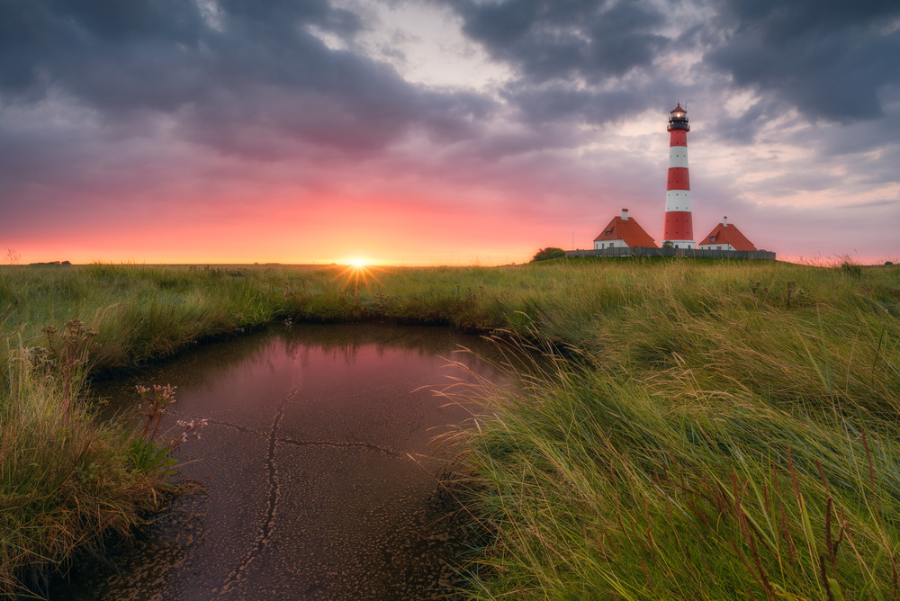A piece of fine art art photography titled Terp Inferno (Lighthouse Westerheversand) by Dirk Wiemer
