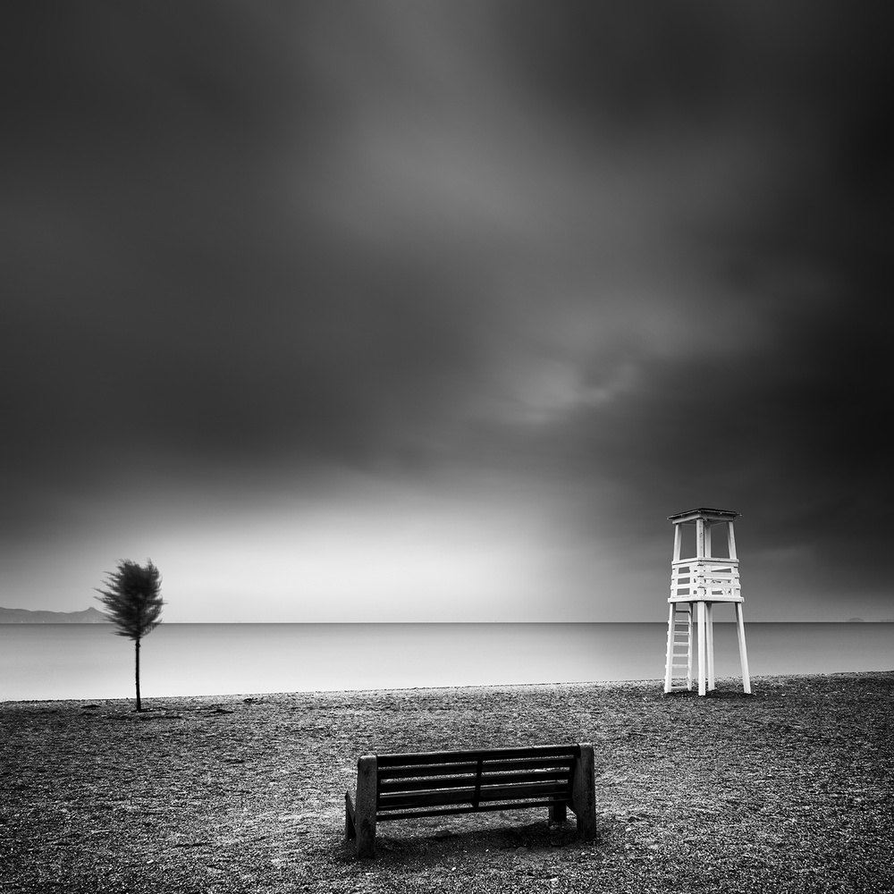 A piece of fine art art photography titled Bench On the Beach by George Digalakis