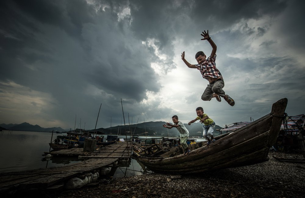 A piece of fine art art photography titled Children and Boats by D-H Xia