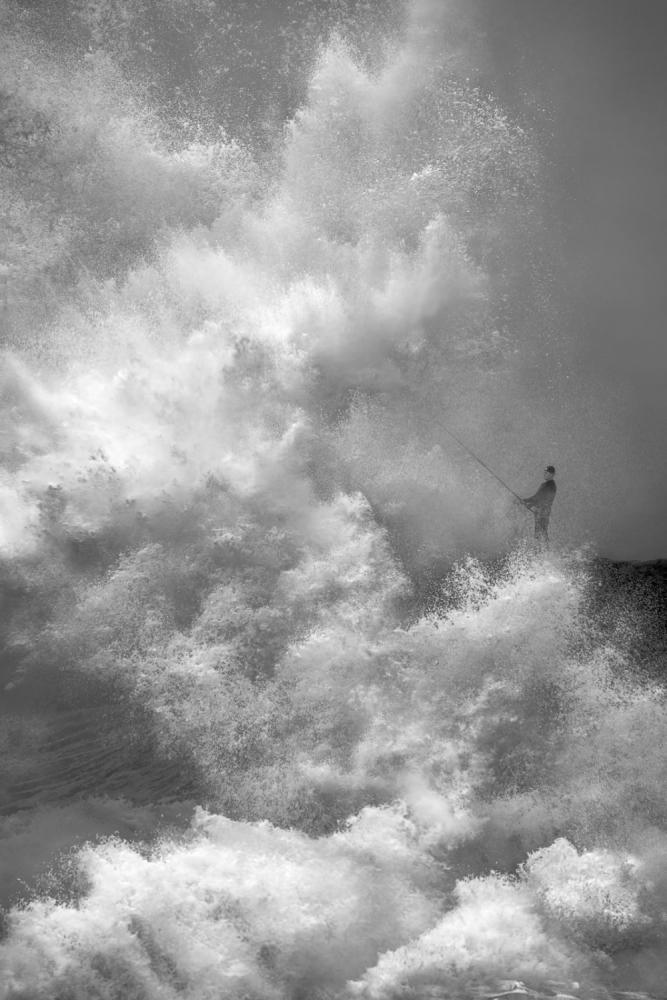 A piece of fine art art photography titled Diehard Fisherman by John Fan