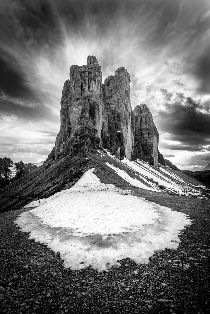 A piece of fine art art photography titled Tre Cime Tear of Snow by Franco Ameli