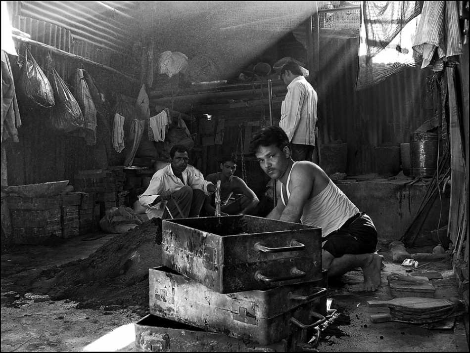 A piece of fine art art photography titled Work In the Slum by Odino Vignali