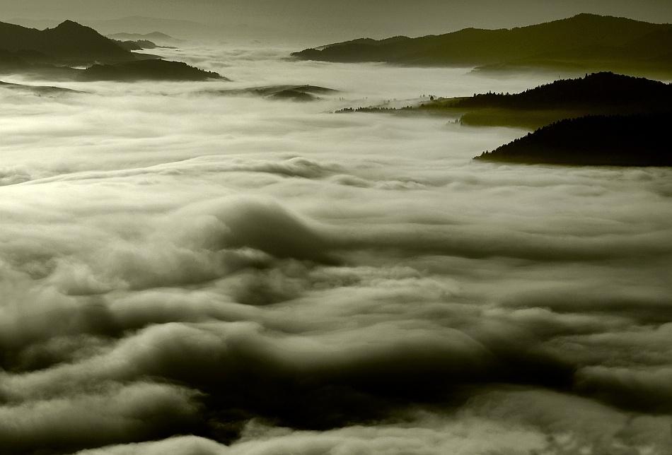 A piece of fine art art photography titled In the Mist`s Sea by Janusz Wanczyk