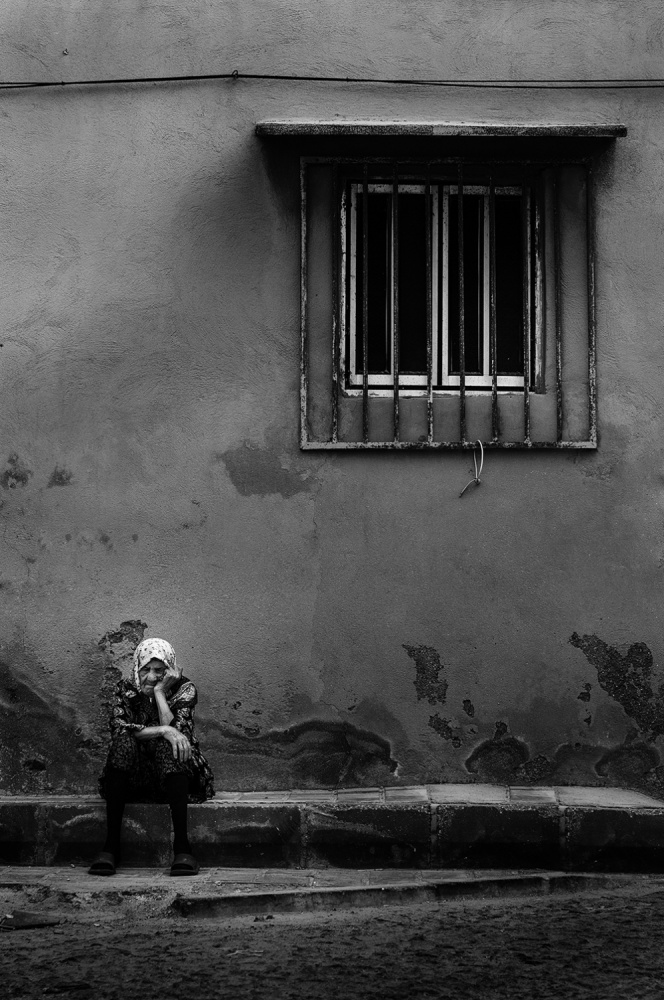A piece of fine art art photography titled Alone Grandmother by Saeed Arabzadeh