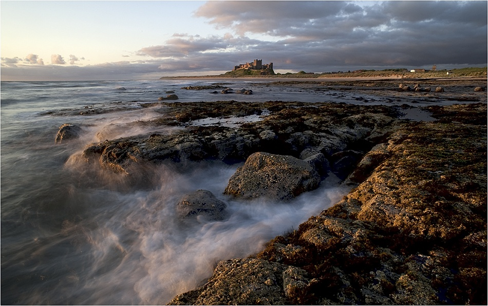 A piece of fine art art photography titled Bamburgh Dawn by Andrew Thatcher