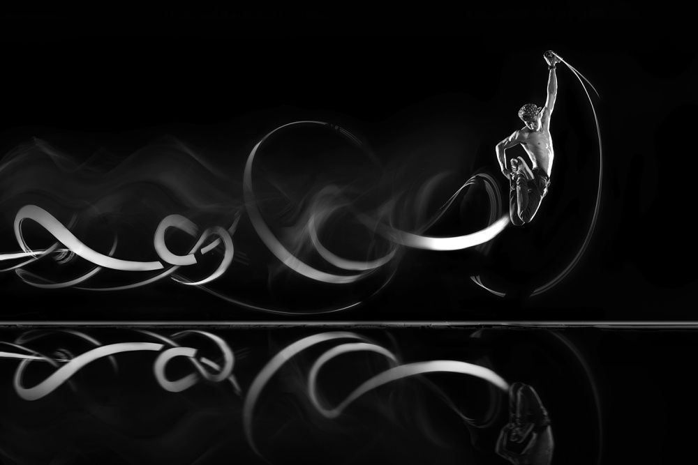 A piece of fine art art photography titled Dancing With a Light by Evigh Santoso