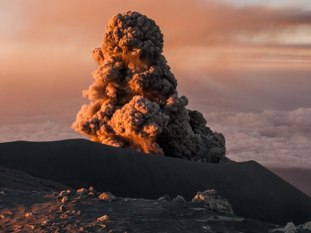 Eruption of Semeru volcano in early morning light