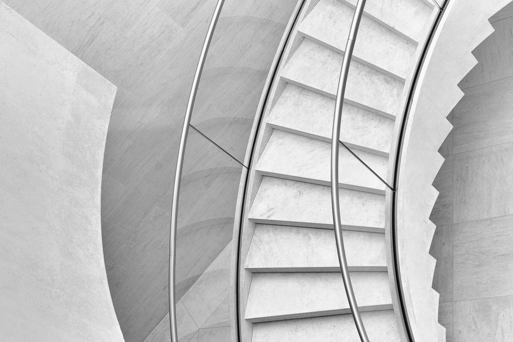 A piece of fine art art photography titled Stairs In Curves by Jeroen van de Wiel