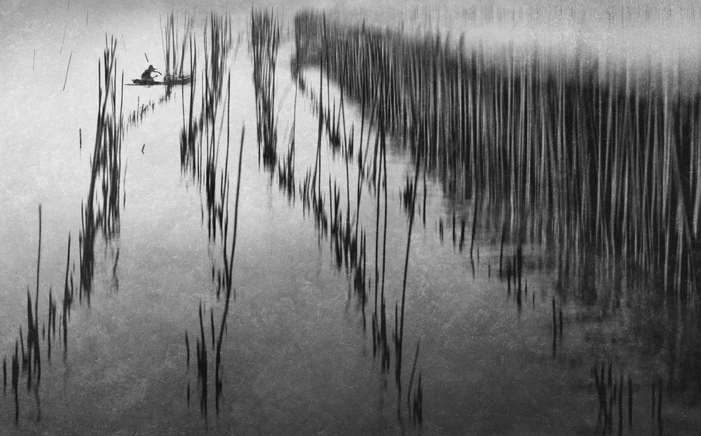 A piece of fine art art photography titled Behind the Wall by Ekkachai Khemkum