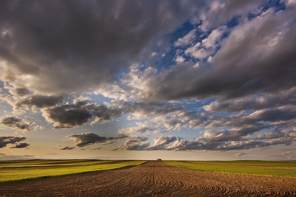 A piece of fine art art photography titled Farmland Under a Big Sky by Doug Roane