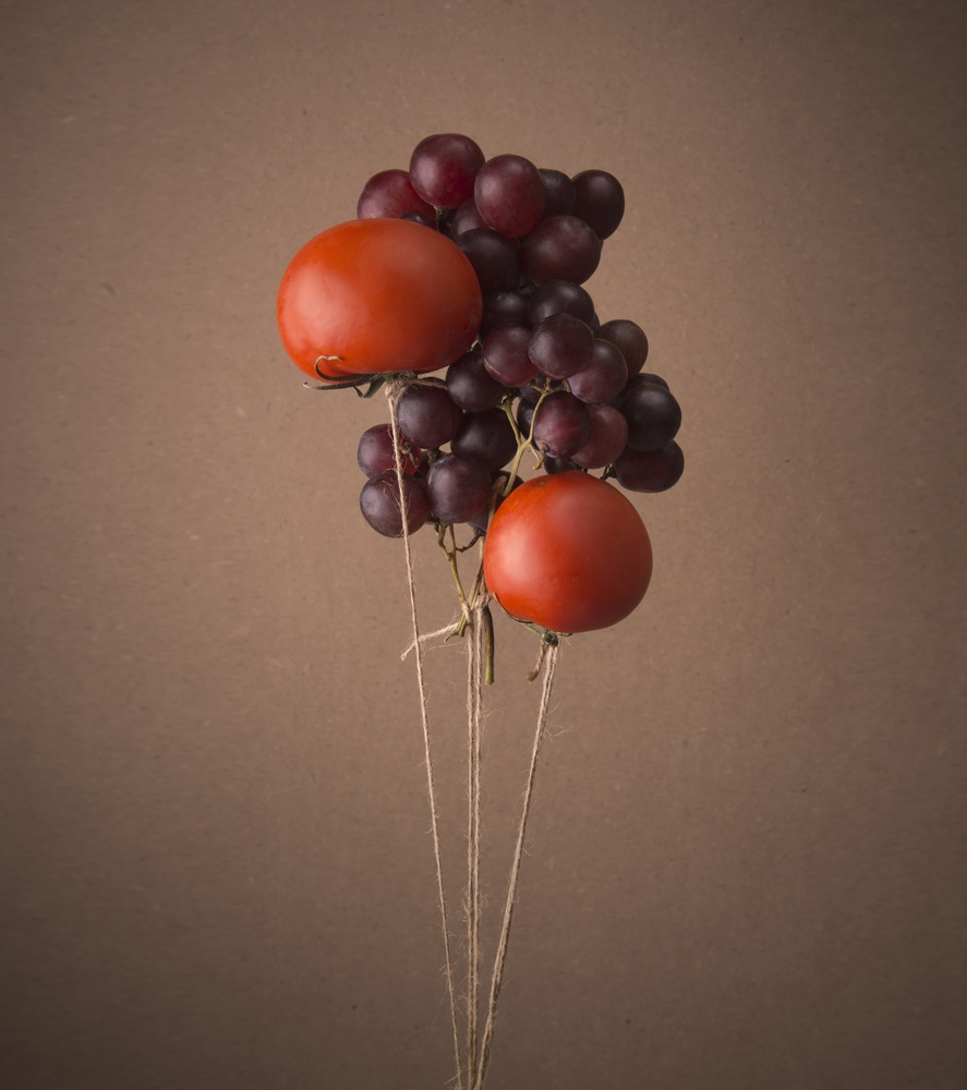 View this piece of fine art photography titled Flying fruits by Inna Karpova