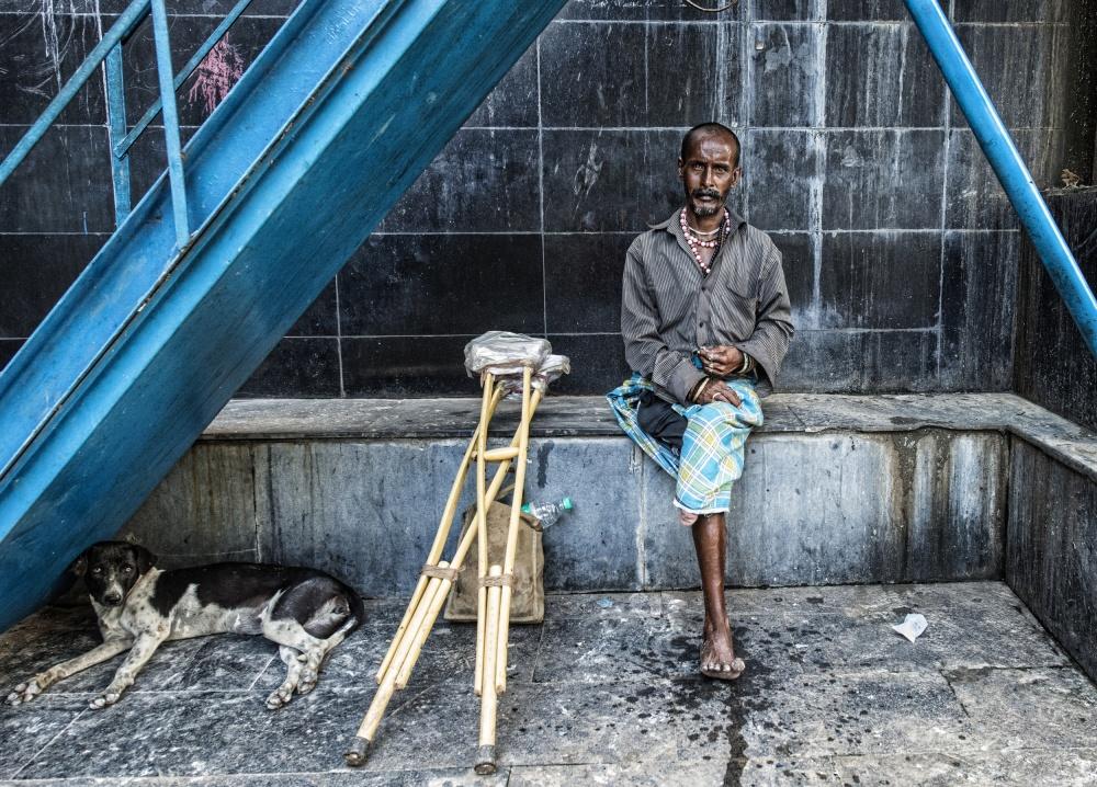 A piece of fine art art photography titled The Man and the Dog (Kolkata, India) by Joxe Inazio Kuesta Garmendia