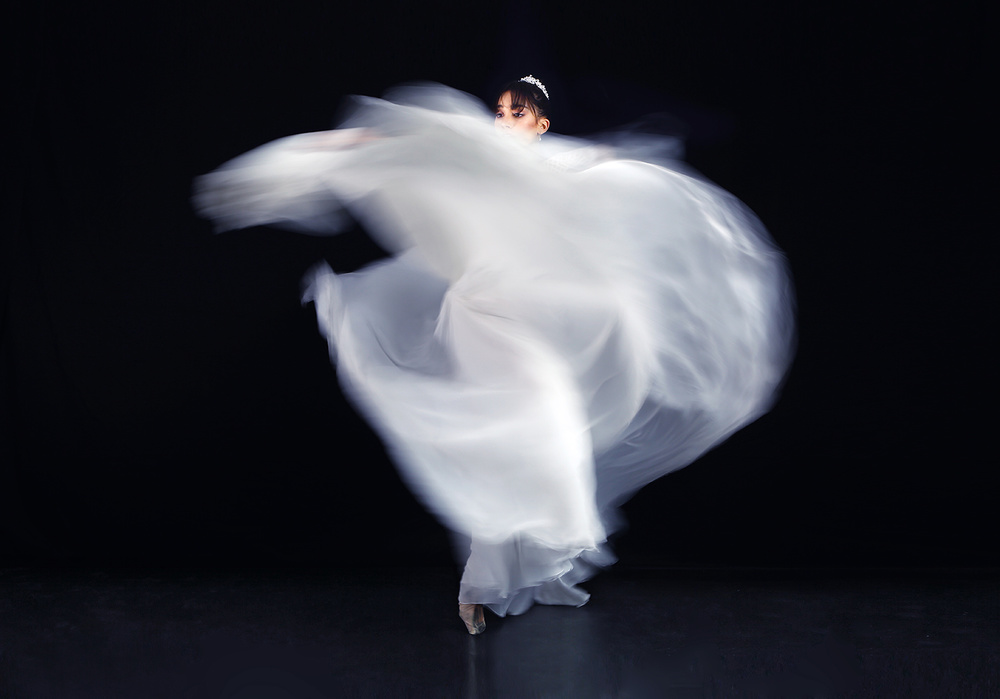 A piece of fine art art photography titled Classic Spin -2 by Osher Partovi