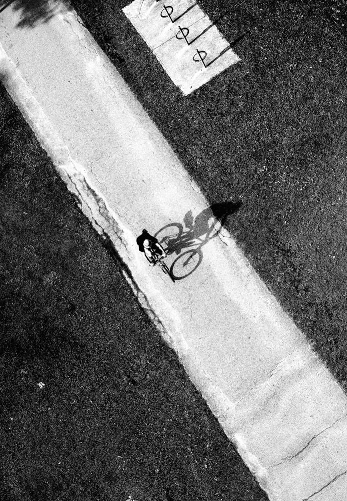 A piece of fine art art photography titled Cycling Sunset by Jian Wang