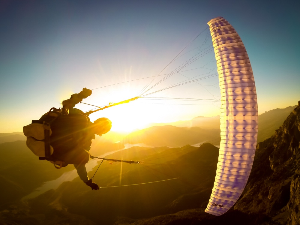 A piece of fine art art photography titled Wing Over at Sunset With Maxime Chiron by Tristan Shu
