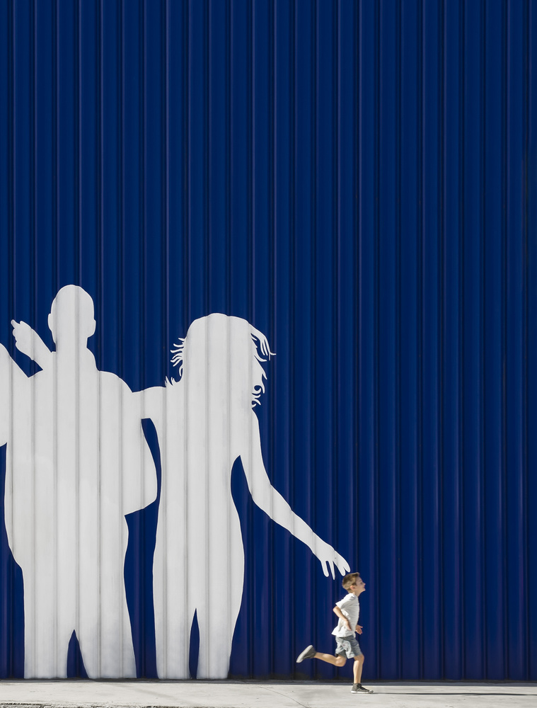 A piece of fine art art photography titled Young Couple With Son by Andrés Gámiz
