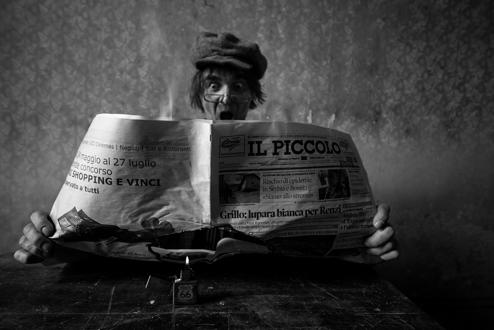 A piece of fine art art photography titled Burning News by mario grobenski - psychodaddy