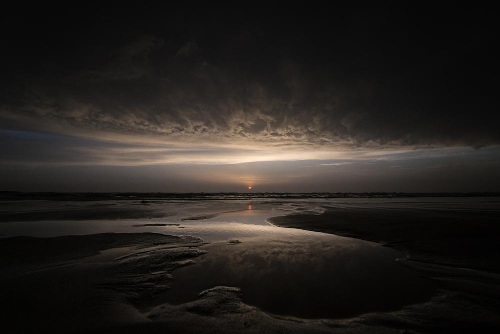 A piece of fine art art photography titled Biscarrosse Sunset by Arnd Gottschalk