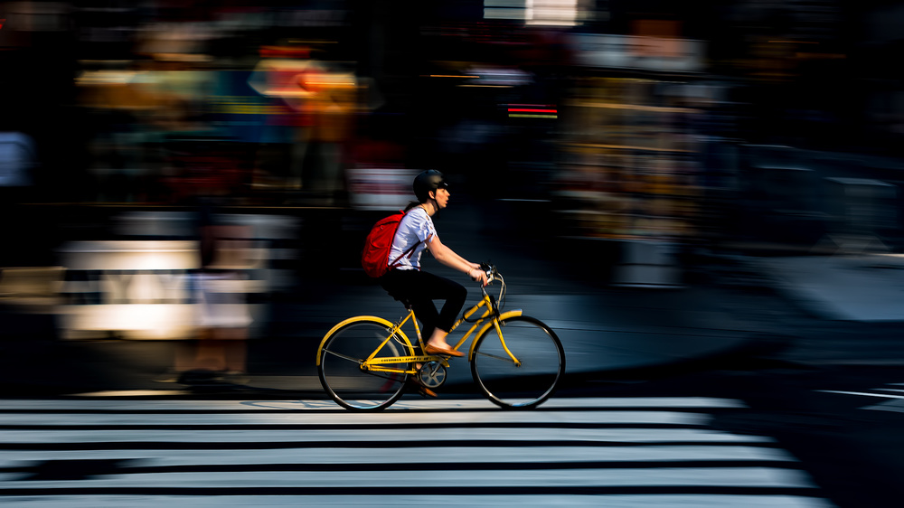 A piece of fine art art photography titled A Bicyclist by Hanping Xiao