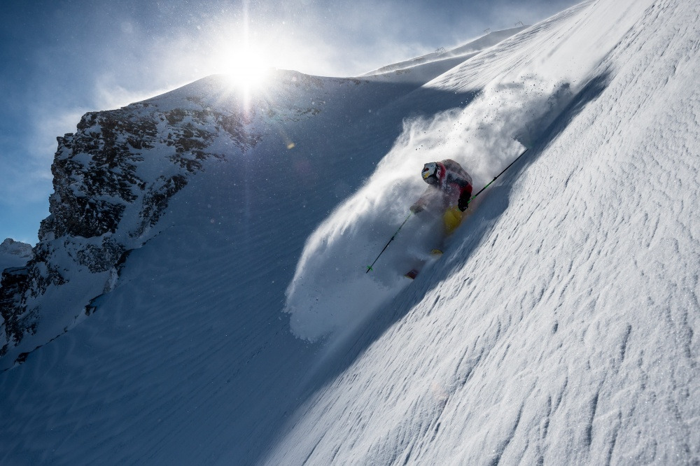 A piece of fine art art photography titled Steep Powder Turn With Charles Navillod by Tristan Shu